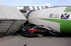 چپ کردن کامیون بر روی یک خودرو برای فرار از تصادف شاخ به شاخ