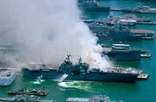 ناو جنگی آمریکایی همچنان در آتش میسوزد